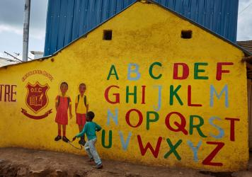 In his new book for young teenagers, Charles Kenny points out signs of global progress, including the growing number of kids in school. Above: The Oloo Education Center aims to provide an education to kids in Kibera, a poor community in Nairobi, Kenya. W