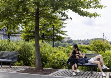 People relax at the Georgetown Waterfront Park on Monday in Washington, D.C. While pandemic restrictions have been lifted for much of the country, the Delta variant of COVID-19 is hospitalizing thousands of people in the U.S. who have so far not gotten a