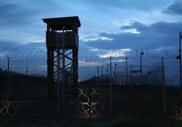 Razor wire and a guard tower stands at a closed section of the U.S. prison at Guantánamo Bay on Oct. 22, 2016.