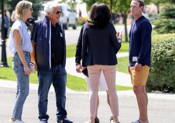 From left to right, Dana Blumberg stands next to her boyfriend, New England Patriots owner Robert Kraft, Facebook COO Sheryl Sandberg and Facebook CEO Mark Zuckerberg as they talk after a session at the Allen & Company Sun Valley Conference on Thursday i