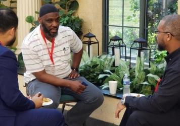 Abdul Muhaymin al-Salim (center), a 49-year-old who was formerly incarcerated on drug charges, works at the Tayba Foundation, where he mentors incarcerated Muslims.