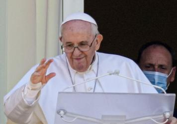 Pope Francis appears on a balcony of the Agostino Gemelli Polyclinic in Rome, Sunday, July 11, 2021, where he is recovering from intestinal surgery, for the traditional Sunday blessing and Angelus prayer. Pope Francis is 84 and had a part of his colon re