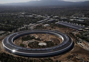 """Apple's massive"""" spaceship"""" campus designed to centralize work and foster collaboration in 2017 may have to make way for satellite offices and other remote work."""