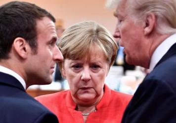 German Chancellor Angela Merkel with then-President Donald Trump and French President Emmanuel Macron at the start of the G20 meeting in Hamburg, Germany, on July 7, 2017.