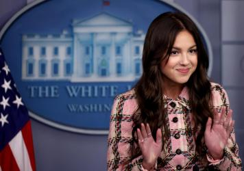 Pop star Olivia Rodrigo makes a brief statement to reporters Wednesday in the Brady Press Briefing Room at the White House.