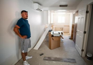 Joshua Ray, a social worker with the Scotts Valley Band of Pomo Indians, inside one of the apartments of the building tribal leaders bought in Lakeport, Calif., through Homekey.