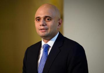 U.K. Health Secretary Sajid Javid, pictured in 2015, tested positive for coronavirus on Saturday. The nation is poised to lift sweeping restrictions, despite a spike in cases led by the delta variant.
