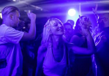 People dance at Egg London nightclub early Monday in the British capital.