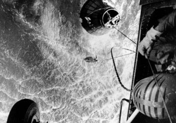 A U.S. Marines helicopter hovers over the Atlantic ocean during an attempt to retrieve astronaut Gus Grissom's Liberty Bell 7, which sank 15,000 feet shortly after splashdown on July 21, 1961.