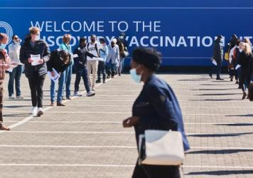 Residents wait to register at a mass vaccination site in Johannesburg on July 8.