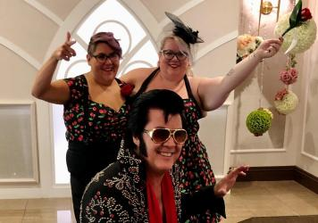 Brendan Paul (center) poses in front of newlyweds Jess Sandoval and Alana Stroebel at the Graceland wedding chapel in downtown Las Vegas.