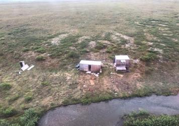 The survivor of a bear attack was rescued from a remote mining camp near Nome, Alaska, by a Coast Guard Air Station Kodiak crew earlier this month.