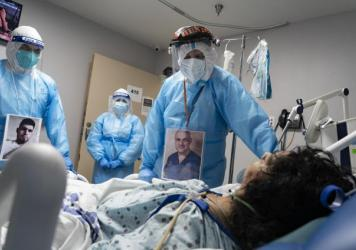 Medical staff members check on a patient in the COVID-19 Intensive Care Unit at United Memorial Medical Center in Houston last November. Doctors are now investigating whether people with lingering cognitive symptoms may be at risk for dementia.