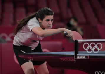 Syria's Hend Zaza competes during women's table tennis singles preliminary round match against Austria's Liu Jia at the 2020 Summer Olympics in Tokyo.