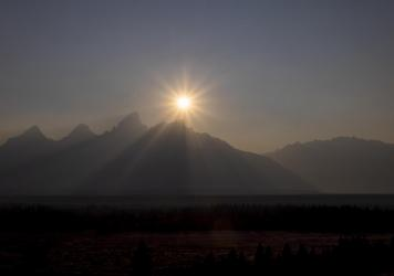 A peak is shrouded in smoke from regional wildfires on July 14, at Grand Teton National Park, south of Yellowstone.