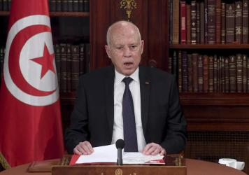 Tunisia's President Kais Saied leads a security meeting with members of the army and police forces in Tunis, Tunisia, on Sunday. Troops surrounded the parliament building and blocked its speaker Rached Ghannouchi from entering Monday after the president