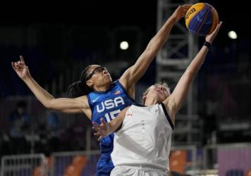 U.S. player Allisha Gray blocks a shot by Yulia Kozik from Russia on Sunday during a women's 3-on-3 basketball game at the 2020 Summer Olympics in Tokyo.