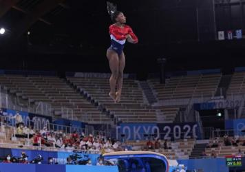 Simone Biles from the U.S. performs on the vault during the gymnastics women's team final at the Summer Olympics on Tuesday in Tokyo.