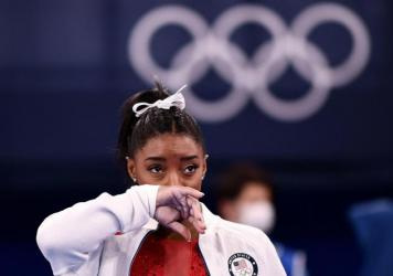 Simone Biles looks on during the women's gymnastics team final during the Tokyo Olympics on Tuesday.