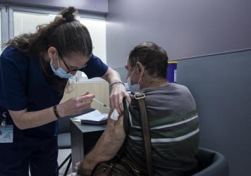 A man receives the Pfizer COVID vaccine in Ramat Gan, Israel. A small Israeli study suggests vaccinated people who experience rare breakthrough infections may develop symptoms that last as long as six weeks.