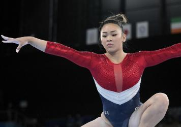 Sunisa Lee, of the United States, performs on the balance beam during the artistic gymnastics women's final at the 2020 Summer Olympics, Tuesday, July 27, 2021, in Tokyo.
