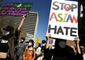People demonstrate against anti-Asian violence and racism on March 27, 2021 in Los Angeles. A week earlier eight people were killed at three Atlanta-area spas, six of whom were Asian women, in an attack that sent fear through the Asian community amid a r