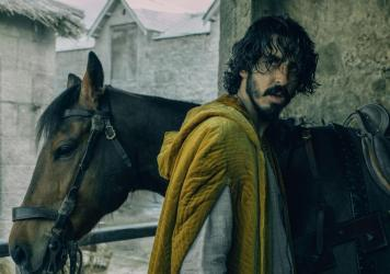 At the beginning of the new movie <em>The Green Knight</em>, Dev Patel's Gawain is the young headstrong nephew of King Arthur. He isn't a knight yet and has a lot to prove.