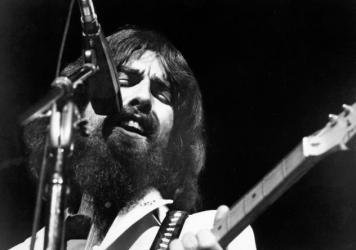"""George Harrison performs at the Concert for Bangladesh, held at Madison Square Garden on August 1, 1971 in New York City. Asked why he joined in organizing the event, he said, """"Because I was asked by a friend if I'd help, that's all."""""""