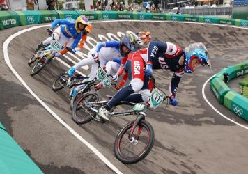 Connor Fields, of Team USA, leads the pack in a Men's BMX semifinal on Friday. He crashed not long after and was taken to the hospital.