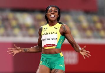 Elaine Thompson-Herah of Team Jamaica celebrates after winning the gold medal in the women's 200-meter final at the Tokyo Olympics on Tuesday.