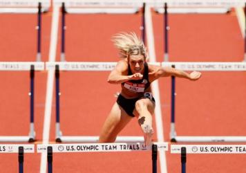 Annie Kunz in the women's heptathlon 100-meter hurdles during the Olympic trials in Eugene, Ore., in June. Building her training regimen around recent findings from sex-specific sports medicine research has made a difference in her performance, says Kunz