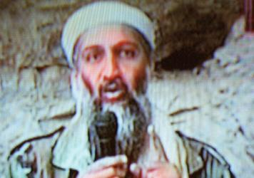 Osama bin Laden is seen at an undisclosed location in a television image broadcast on Oct. 7, 2001.