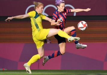 Australia's defender Clare Polkinghorne (left) fights for the ball with Team USA forward Megan Rapinoe during the women's bronze medal soccer match on Thursday at the Tokyo Olympics.