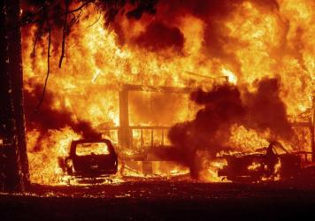 Flames consume a home on Highway 89 as the Dixie Fire tears through the Greenville community of Plumas County, Calif., on Wednesday, Aug. 4, 2021.