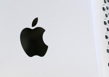 This May 21, 2021 photo shows the Apple logo displayed on a Mac Pro desktop computer in New York. Apple is planning to scan U.S. iPhones for images of child abuse, drawing applause from child protection groups but raising concern among security researche