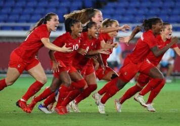 Canada celebrates after defeating Sweden to win gold in the women's soccer final at the Tokyo Olympics.