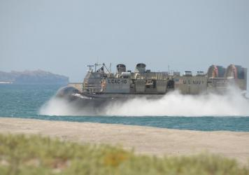 A U.S. Navy hovercraft prepares to hit the beach during amphibious-landing exercises as part of an annual joint U.S.-Philippine military exercise on the shores of San Antonio, facing the South China Sea, in Zambales province, Philippines, on April 11, 20