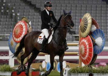 Annika Schleu of Germany cries after failing to control her horse while competing in the equestrian portion of the women's modern pentathlon at the 2020 Summer Olympics on Friday.