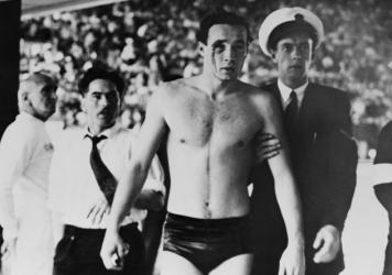 Hungary's Ervin Zador is led from the pool with blood pouring from a cut eye, as a water polo match with the Soviet Union descended into chaos at the 1956 Melbourne Olympics. The Games played out in a volatile time — and thanks to a 17-year-old's lette