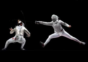 Over two weeks, critic Linda Holmes watched every Olympic discipline, from archery to wrestling. Above, Manon Brunet of Team France, left, competes against Olga Nikitina of Team ROC during the Women's Sabre Team Fencing Gold Medal Match on day eight of t