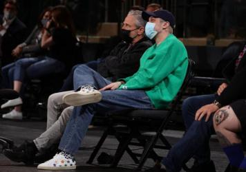 Jon Stewart and Pete Davidson sit court-side at a New York Knicks game on April 21, 2021 at Madison Square Garden in New York City, New York. They will hold a comedy special to benefit 9/11 charities there in September.