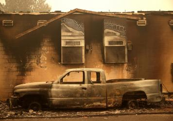 A burned truck sits parked next to a property that was destroyed by the Dixie Fire on August 11, 2021, in Greenville, California. The Dixie Fire, which has incinerated over 500,000 acres, is the second-largest recorded wildfire in state history. The fire