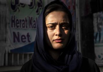 Dawlatt Naimati, 22, from Kunduz, stands outside an internet café where she is seeking help applying for a U.S. special immigrant visa on Aug. 8, in Kabul, Afghanistan.