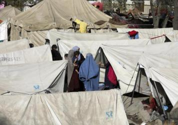 Internally displaced Afghans who have fled from northern provinces due to fighting between the Taliban and Afghan security personnel take refuge Friday in a park in Kabul.
