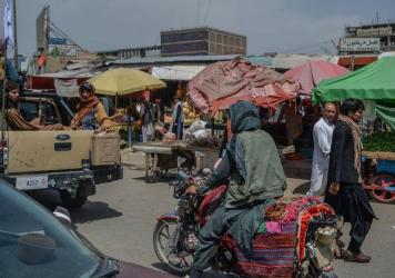 Taliban fighters on a pickup truck move around a market area Tuesday in Kabul, Afghanistan's capital.
