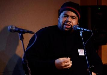 """Chucky Thompson speaks at a Recording Academy event in January 2009. The late producer created some of the most celebrated hits of the '90s """"hip-hop soul"""" era."""
