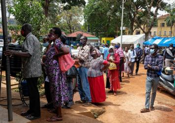 People line up last week to receive COVID-19 vaccines in Kampala, Uganda, after weeks of no supply. In Uganda, only 2.2% of the population had received one dose of a vaccine as of Aug. 15.