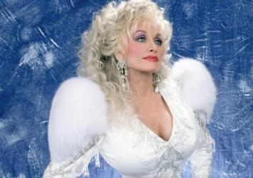 Singer-songwriter Dolly Parton's persona has taken on an almost saint-like manifestation in recent years, writes Amanda Marie Martinez.