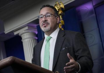 U.S. Education Secretary Miguel Cardona speaks at a March briefing at the White House.