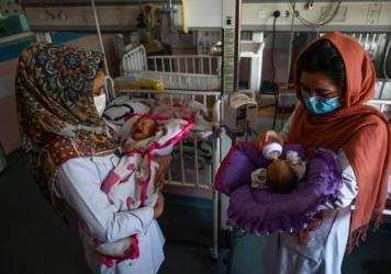 Nurses feed newborn babies rescued and brought to Ataturk National Children's Hospital in Kabul, Afghanistan, on May 15, 2020, after their mothers were killed in an attack on a maternity ward operated by Doctors Without Borders. The health-care nonprofit